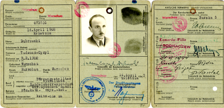 Copy of an unfolded identity document, split in three pages. The pages include red and blue stamps, typed and handwriting information, as well as two black fingerprints. The middle page has a black-and-white identity photograph of a man with a moustache, wearing a suit.
