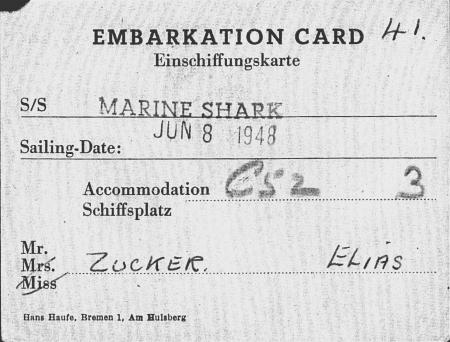 """Copie d'une carte d'embarquement. Le document est typographié et il y a une étampe indiquant """"MARINE SHARK JUN 8 1948"""", il y a aussi de l'écriture manuscrite."""