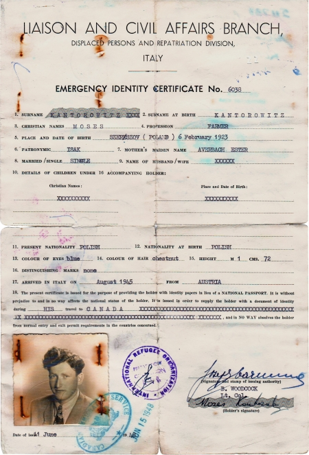 Copy of an aged yellow identity document. It contains typed text with handwritten signatures, stamps, and a black-and-white identity photograph in the bottom-left corner of a young man.