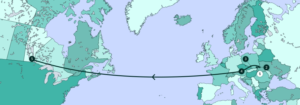Une carte grise illustrant la plupart de l'Amérique du Nord, l'Europe, et partie de l'Afrique. Une ligne traverse divers endroits de la carte.