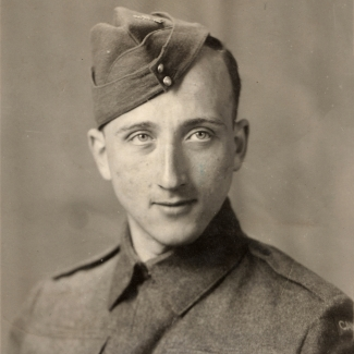 Black-and-white portrait photograph of a man dressed in military uniform, pictured from the chest up.