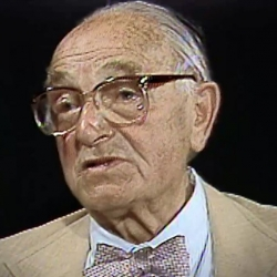 Screenshot of Holocaust survivor Joseph Klinghoffer video testimony. He is sitting in front of a black background, and looking to the left of the camera. The camera shows his face and shoulders.