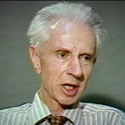 Screenshot of  Holocaust survivor Stefan Carter video testimony. He is sitting in front of a dark background and looks to the right of the camera. The camera shows his face and shoulders.
